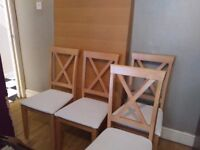 Extendable dining table with 4 newly upholstered chairs