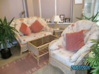 Conservatory cane 2 seater settee and armchair + 2 coffee tables in good condition