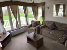 Front row sea view caravan with decking at Southerness Holiday Park - includes 2018 site fees
