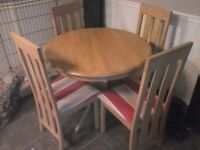 light oak round table and 4 chairs