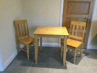 Solid oak dining table with 2 chairs