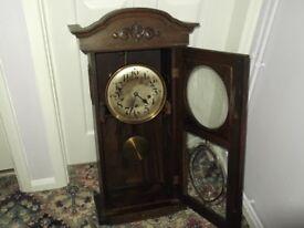 Edwardian oak wall clock. Glazed Astragal panels