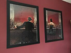 Pair of framed posters in large black frames