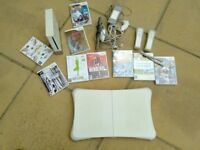 Wii - plus Wii fit board and numerous games