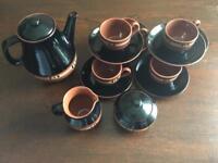 Teapot, sugar bowl, milk jug, cups and saucers