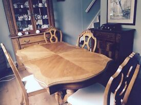 A beautiful reproduction dining room suite. 6 chairs 3 cabinets excellent condition
