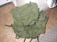 A large green rucksack with side pouches.