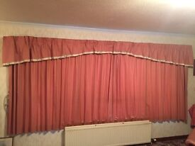 Pink curtains with pelmet and tied backs
