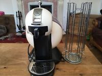 Nescafé dolce gusto cream in colour, good condition, comes with pod stand