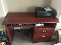 Mahogany finish home desk with two storage drawers and keyboard drawer