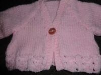 Pink baby aran hand knitted jacket