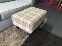 Footstool in checked pattern