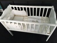 White wooden crib, Teddy's Toy Box crib bail and Airflow mattress.