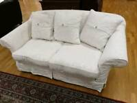 White fabric 3 and 2 seater sofa with cushions