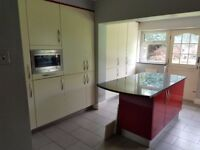 Cream Kitchen units and microwave for sale.