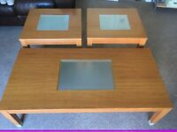 Large coffee table and Two side tables, wood with glass inserts.