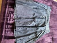 Ladies short denim skirt with pockets