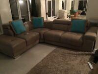 Dark beige real leather large corner sofa .. has an inbuilt iPod player