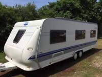 2005 Hobby Prestige Twin axle caravan 5 berth with full awning and fixed bed