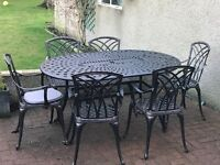 Wrought iron garden table and chairs.