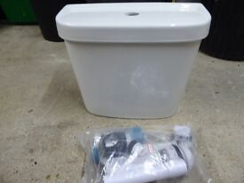 Cistern with push button fitting
