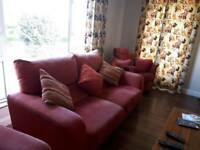 Red three seater sofa, swivel recliner and large armchair