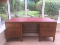 Solid traditional timber desk, with red leather inlay top