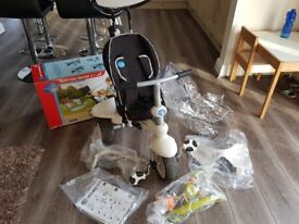 Smart trike 4 in 1 - recliner - excellent condition. With accessories inc rainwear