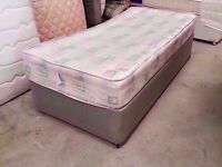 Grey single bed with mattress