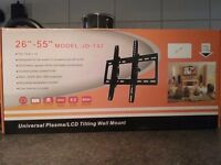 Tilting T.V. wall mount. NEW still in box.