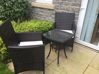 Rattan chairs and small table