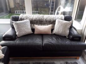 2 black leather two seater sofas in good condition