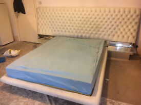 Double bed upholstered used with mirrored glass, good reupholstered project!