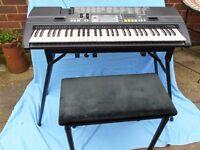 Casio Keyboard (CTK-710 ) plus Stand, Seat Box and some books