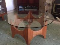 Round glass and hard wood table