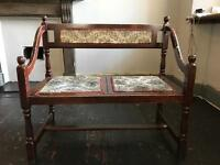Vintage two seater wooden chair