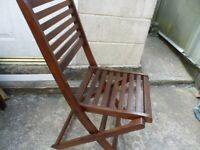 TWO FOLDING WOODEN GARDEN CHAIRS
