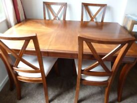 Dining Table and 7 matching chairs. Beautiful wood finish.