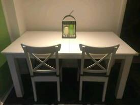 Next Table with storage bench and 4 white Ikea chairs