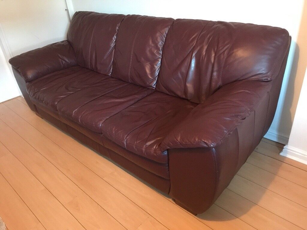 Dark red leather sofa 3 4 seater in cardiff gumtree for Leather sofa 7 seater