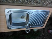 stainless steel kitchen sink with mixer tape and length of worktop