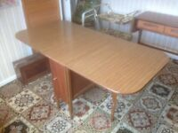 Dining table - with drop down sides and internal storage space- idea for small rooms