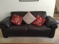 2 seater and 3 seater Natuzzi brown leather sofas . Good condition.