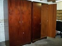 Two matching rosewood wardrobes in excellent condition. £25 or near offer for the pair