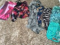 Assorted wraps and swimming suits