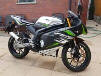 Reiju RS3 50cc Lc Pro with the gorgeous alloy swing arm. Very rare. FSH. Only 2 owners from new.