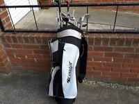 cougar golf bag and a sortment of clubs