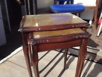 NEST OF TWO TABLES ANTIQUE STYLE WITH LEATHER AND GLASS TOP GOOD USED CONDITION FREE LOCAL DELIVERY