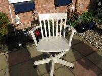 A cream office chair on castors with up and down action, slight wear on arms in good condition.