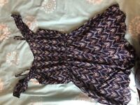 Blue multi-coloured playsuit from H&M - Size 8